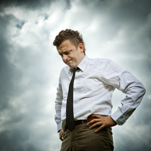 sad businessman with gloomy sky background