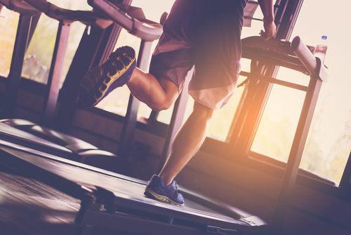 man running on treadmill for cardio