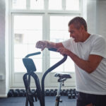 man leaning on stationary bike in gym should hear about Progentra
