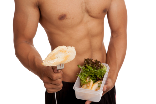 ripped guy who takes Progentra eats chicken breast and salad