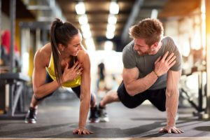 fit couple in gym, gym buddies
