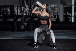 fitness woman hydrating during rest