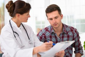 man who takes Progentra having regular checkup with doctor