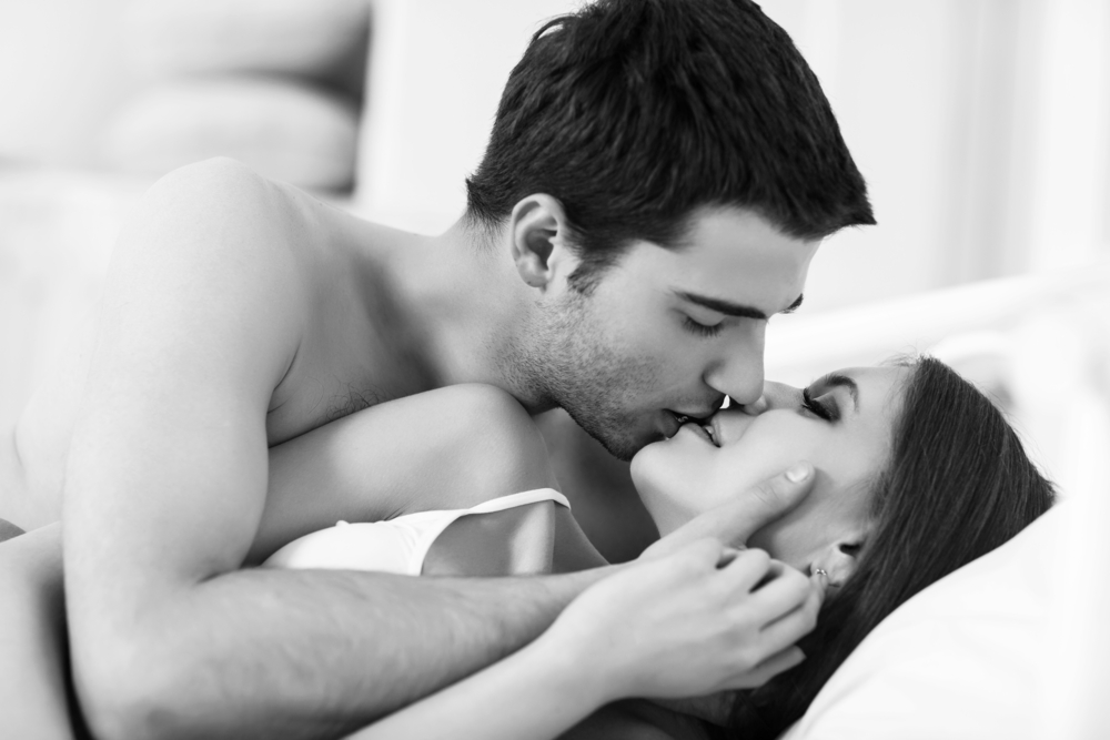 passionate couple kissing in bed man has been taking Progentra supplement