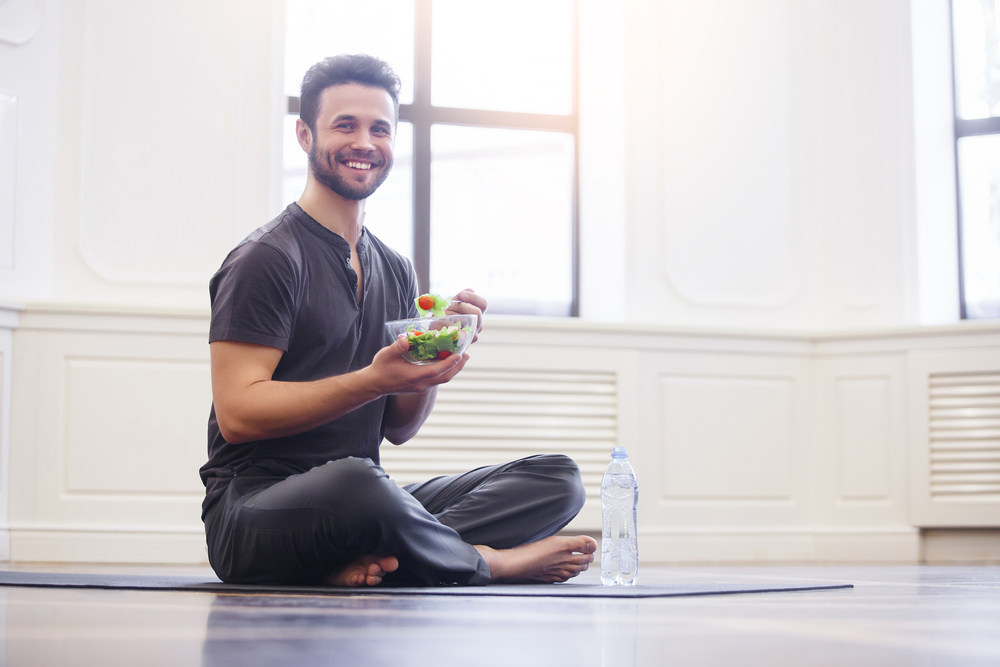 fit guy who takes Progentra eating salad after yoga