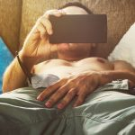 man holding phone while touching his junk after taking Progentra