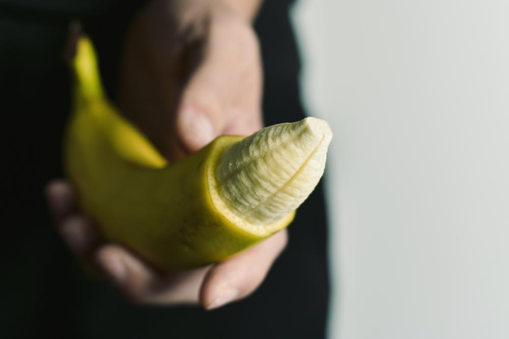 banana unpeeled tip, circumcised penis