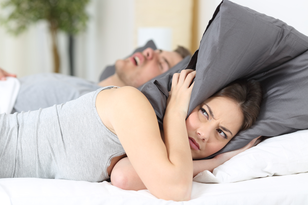 wife irritated by snoring husband