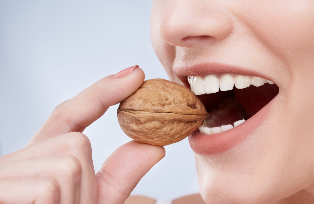 Strong teeth biting walnut